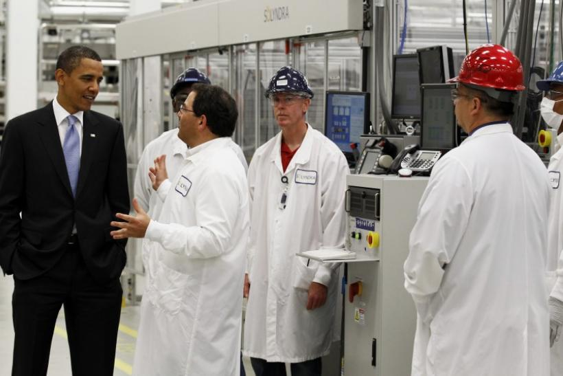 U.S. President Barack Obama tours Solyndra, Inc., a solar panel manufacturing facility in Fremont