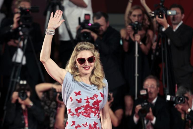 "U.S. pop star and director Madonna arrives on the ""W.E"" red carpet at the 68th Venice Film Festival in Venice"