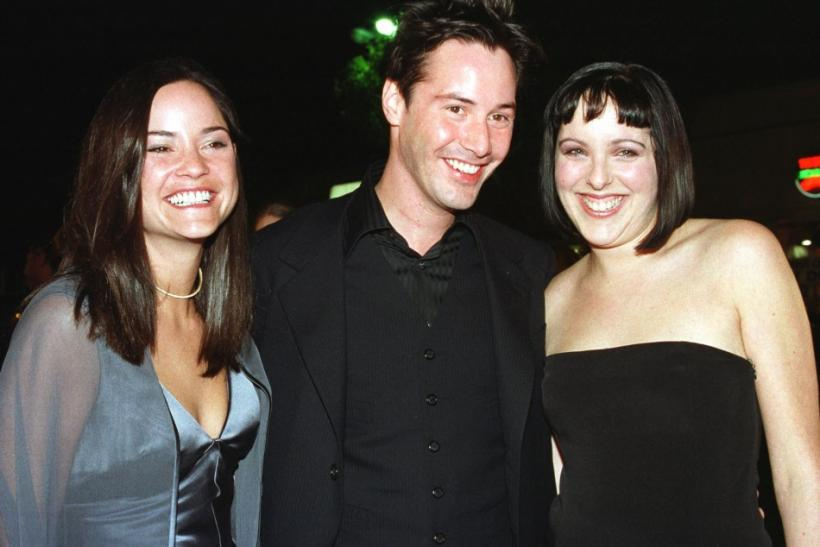 "Actor Keanu Reeves, star of the new science fiction film ""The Matrix"" poses with his siters Kim (L) and Karina at the film's premiere in Los Angeles"
