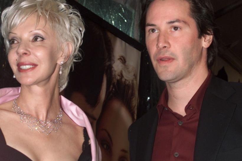 "Actor Keanu Reeves, star of the new film ""Sweet November"" poses with his mother, Patric Reeves as they arrive at the film's premiere in Los Angeles."