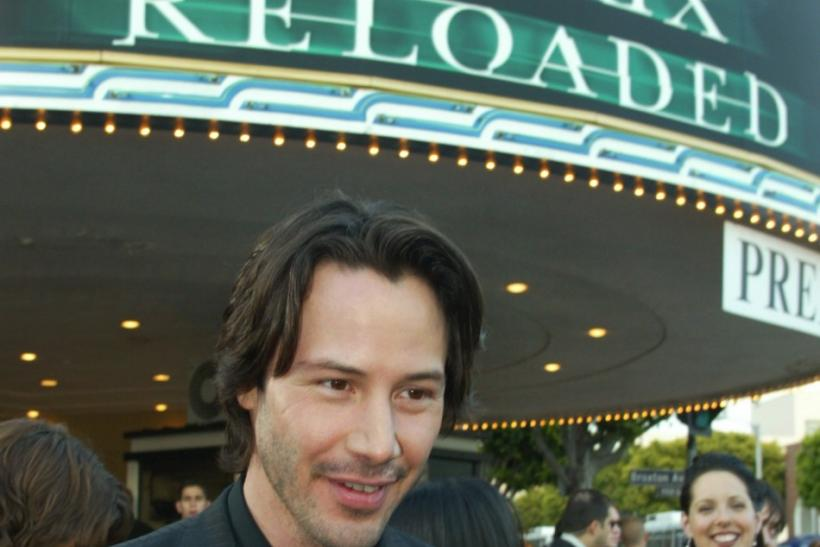 "Actor Keanu Reeves star of the new film ""The Matrix Reloaded"" poses with the theater marquee behind him at the film's premiere in Los Angeles"