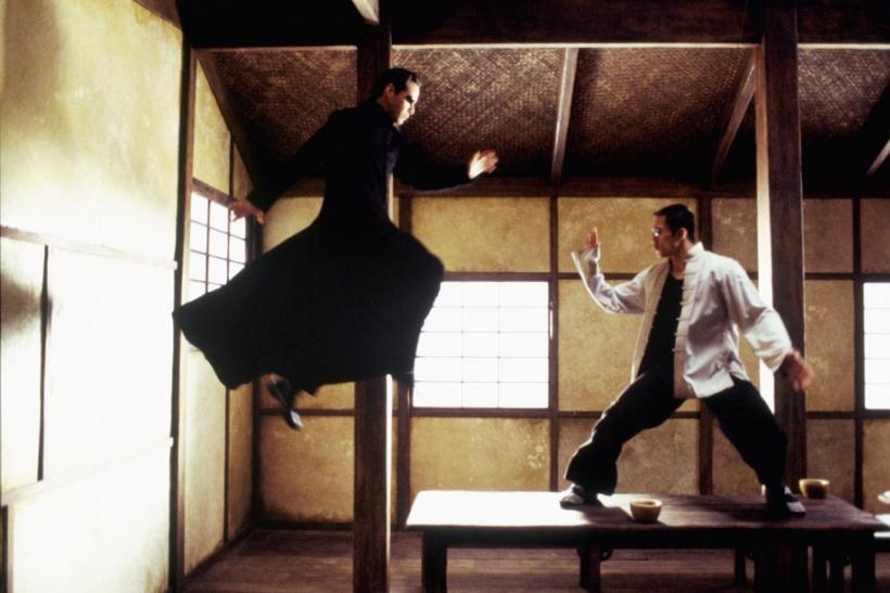 "Actor Keanu Reeves (L) and Collin Chou are shown in a scene from the new futuristic action thriller film""The Matrix Reloaded,"" also starring Laurence Fishburne and Carrie-Anne Moss in this undated publicity photograph."