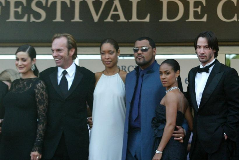 Matrix cast members, from L-R: Canadian actress Carrie-Anne Moss, Australian actor Hugo Weaving, Gina Torres the wife of US actor Laurence Fishburne, US actress Jada Pinkett Smith, and US actor Keanu Reeves pose before the screening of the science-fiction