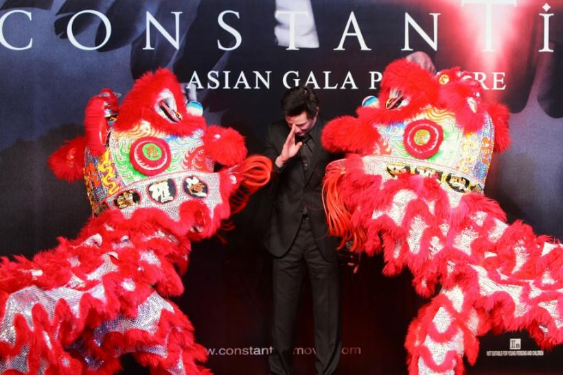 "US actor Keanu Reeves gestures during a Chinese lion dance to celebrate the world premiere of ""Constantine"" in Hong Kong. U.S. actor Keanu Reeves gestures during a Chinese lion dance at the world premiere of his new film ""Constantine"""