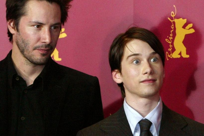 U.S. actor Keanu Reeves and Lou Taylor Pucci (R) pose during a photocall for the film 'Thumbsucker' by director Mike Mills during the 55th Berlinale International Film Festival in Berlin