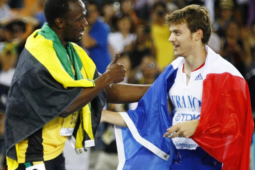 Usain Bolt of Jamaica congratulates Christophe Lemaitre of France after the men's 200 metres final at the IAAF World Athletics Championships in Daegu