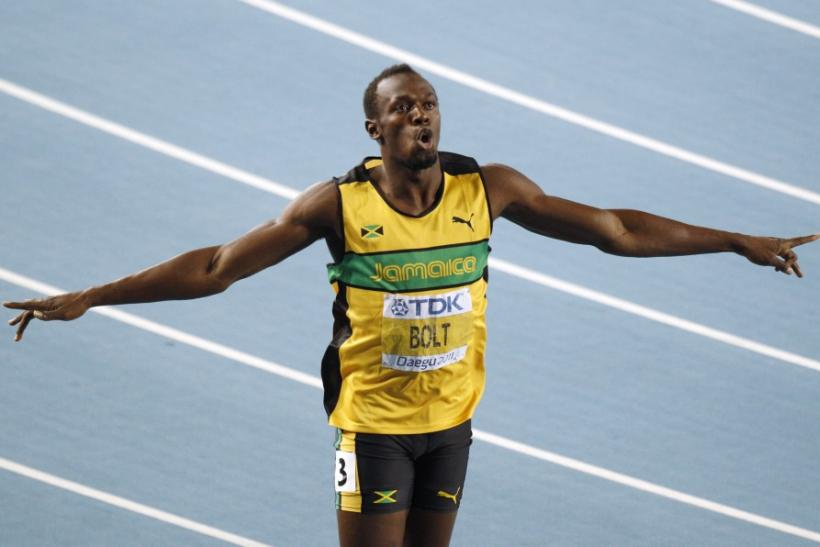 Bolt of Jamaica celebrates winning the men's 200 metres final at the IAAF World Championships in Daegu