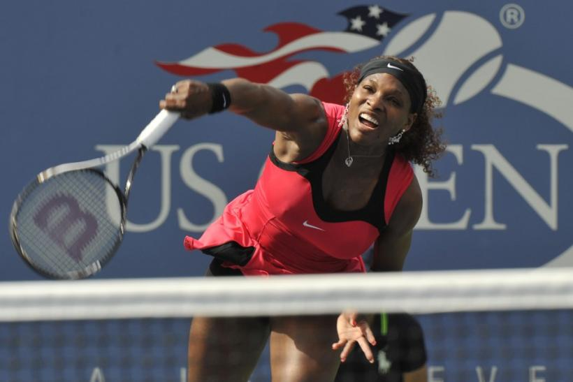Serena Williams of the U.S. hits a serve to Michaella Kajicek of the Netherlands during their match at the U.S. Open tennis tournament in New York