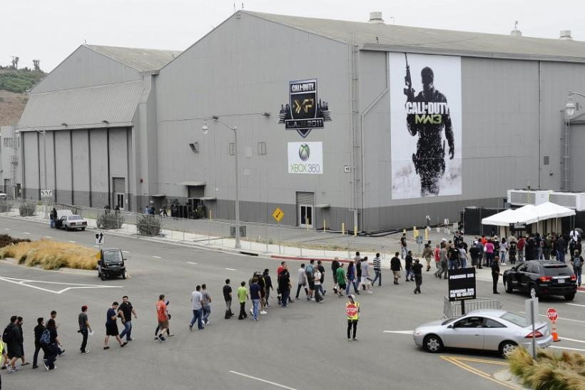 "Fans walk in a line onto the grounds at the premiere of the video game ""Call of Duty: Modern Warfare 3"" in Los Angeles, California"