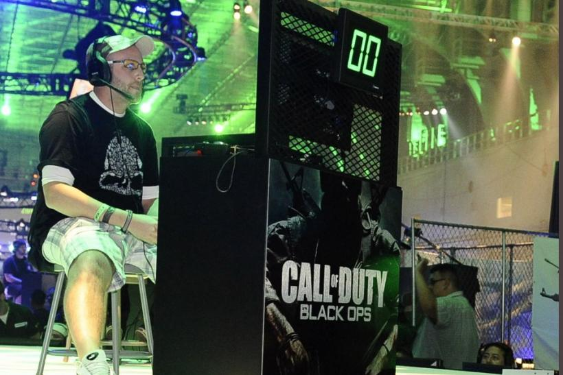 "Fans play video games at the premiere of the video game ""Call of Duty: Modern Warfare 3"" in Los Angeles, California"