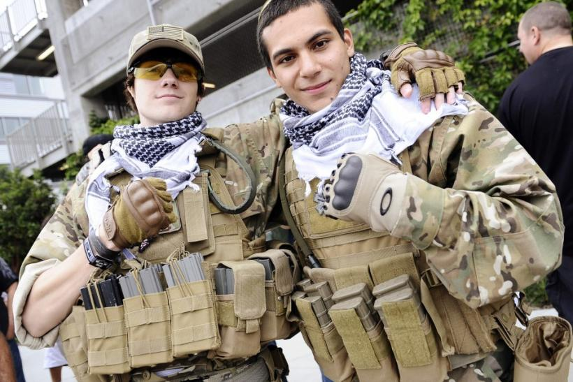 "Matt Lack (L) and Nick De La Torre, both from Colorado, pose dressed in mock military uniforms at the premiere of the video game ""Call of Duty: Modern Warfare 3"" in Los Angeles, California"
