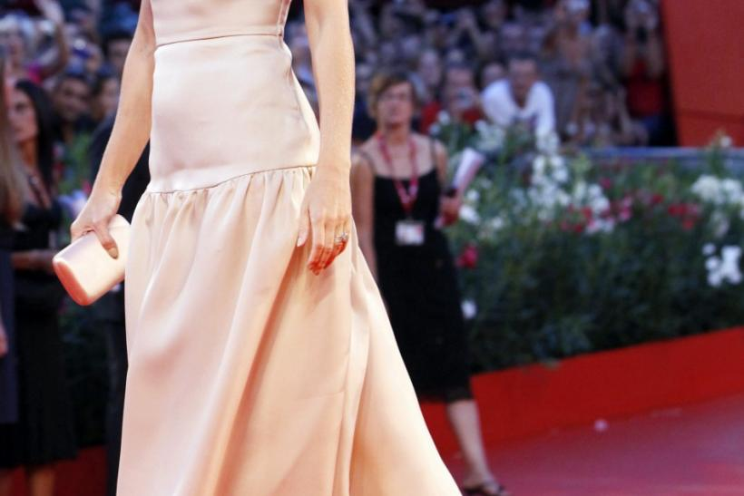 "Actress Gwyneth Paltrow poses for photographers as she arrives on the ""Contagion"" red carpet at the 68th Venice Film Festival"