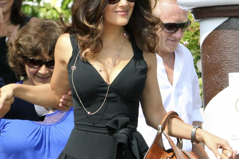 Actress Salma Hayek leaves her hotel by a speedboat during the 68th Venice Film Festival
