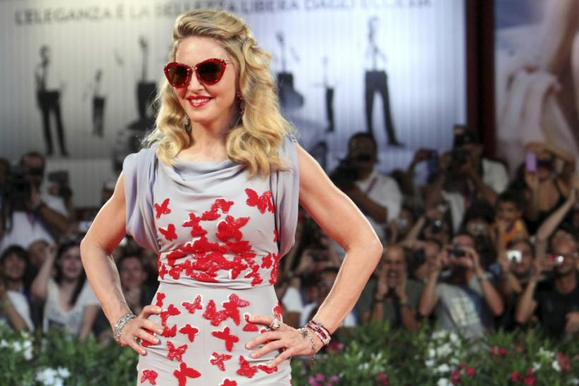 "U.S. pop star and director Madonna, poses for photographers as she arrives on the ""W.E"" red carpet at the 68th Venice Film Festival in Venice"