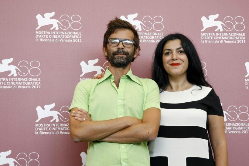 "Directors Paronnaud and Satrapi pose during a photocall of their film ""Poulet aux prunes"" at the 68th Venice Film Festival"