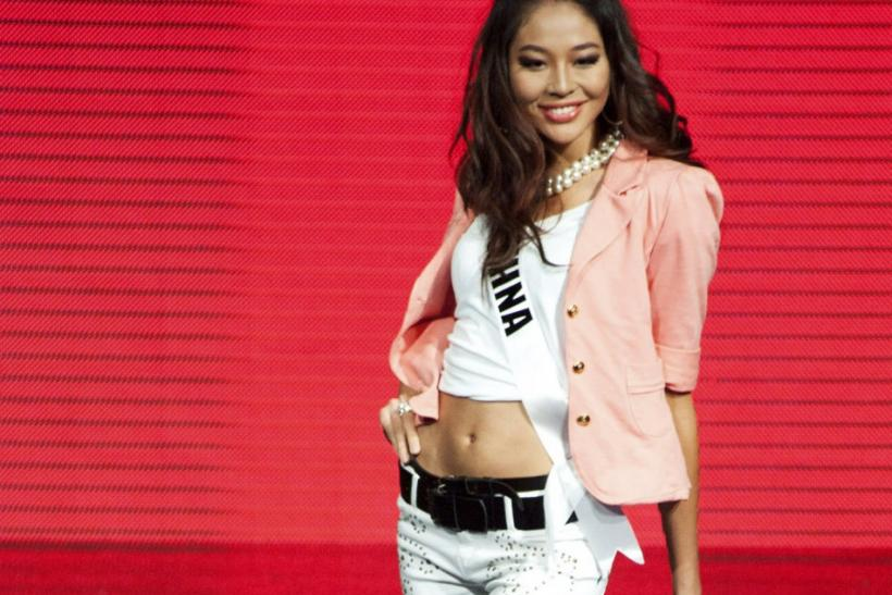 Miss Universe China 2011 Luo Zilin strikes a pose during a fashion show at The Week night club in Sao Paulo