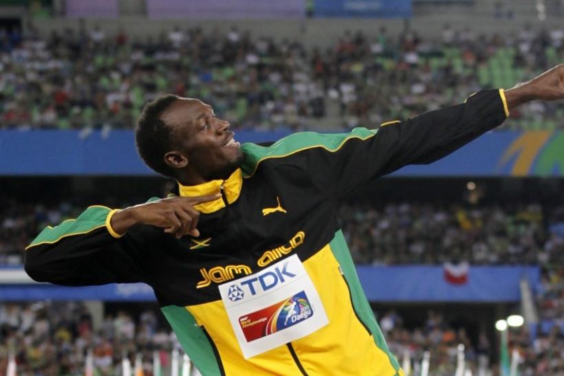 Gold medallist Usain Bolt of Jamaica poses during the award ceremony for the men's 200 metres final at the IAAF World Athletics Championships in Daegu