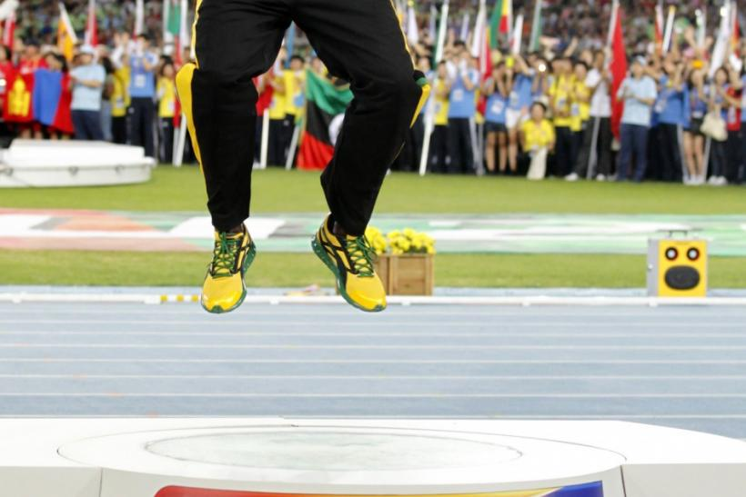 Gold medallist Bolt of Jamaica jumps on podium during the award ceremony for the men's 200 metres final at the IAAF World Athletics Championships in Daegu