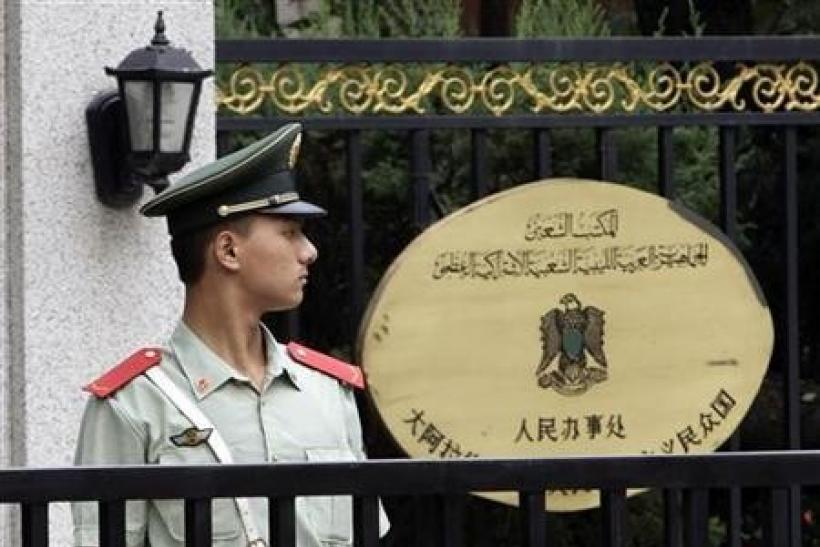 China says didn't know of arms sales talks with Gaddafi forces