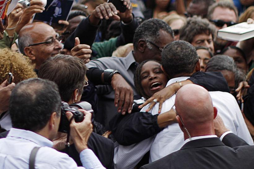 A woman hugs U.S. President Obama at a Labor Day event in Detroit