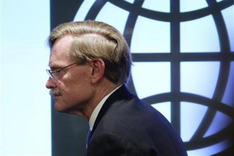 World Bank President Robert Zoellick leaves after a news conference in Beijing