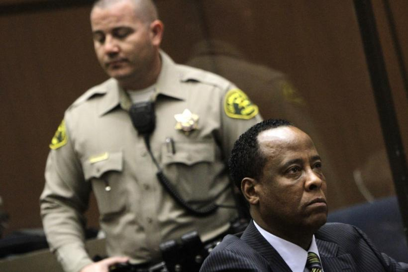 Doctor Conrad Murray listens during his arraignment on a charge of involuntary manslaughter in the pop star's death, in Los Angeles
