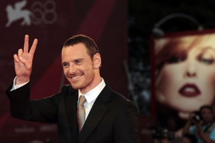 "Actor Fassbender gestures as he arrives on red carpet for film ""A Dangerous Method"" at 68th Venice Film Festival"