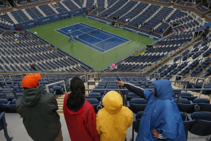 Patrons look down on the court at Arthur Ashe Stadium after rain postponed play in the U.S. Open tennis tournament in New York