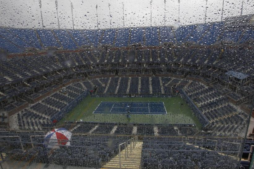 Raindrops are shown on a window overlooking Arthur Ashe Stadium after rain postponed play in the U.S. Open tennis tournament in New York