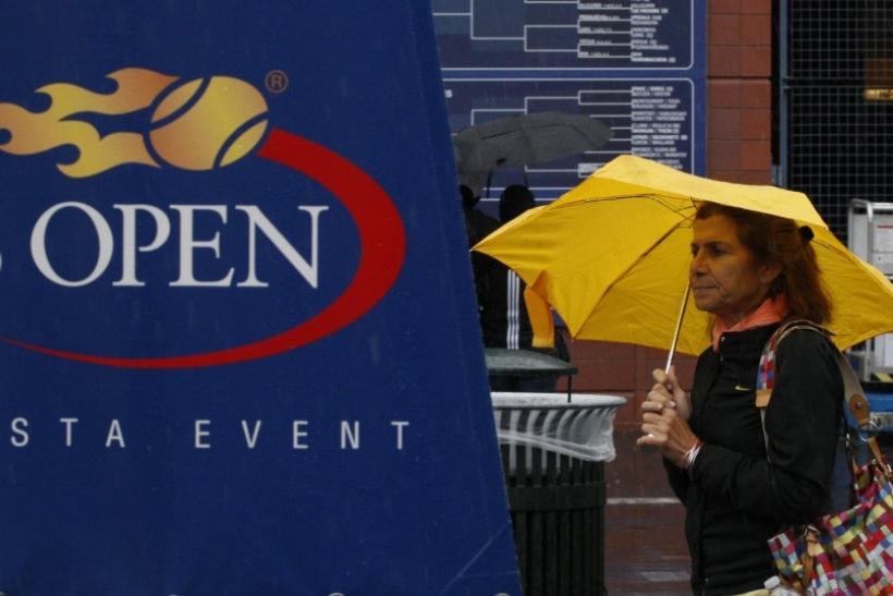 A patron walks outside Arthur Ashe Stadium after rain postponed matches at the U.S. Open tennis tournament in New York