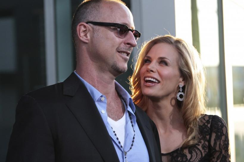 "Director Gavin O'Connor (L) and actress Brooke Burns arrive at the film premiere of ""Warrior"" in Hollywood, California"