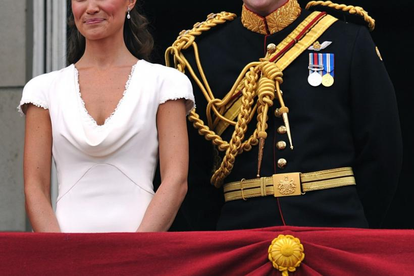 Britain's Prince Harry and Pippa Middleton stand on the balcony of Buckingham Palace in London