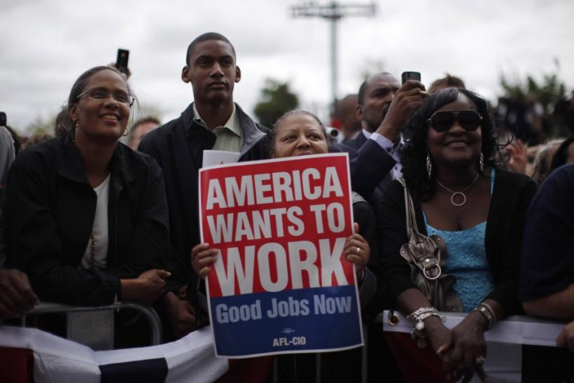 Members of the audience listen to U.S. President Obama at a Labor Day event in Detroit
