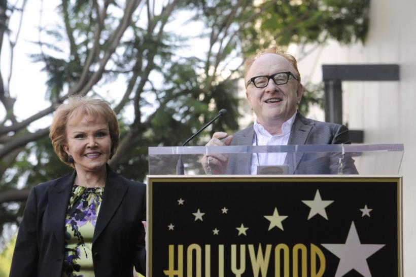 Late musician Buddy Holly's wife Maria Elena Holly (L) looks on as producer Peter Asher speaks during a ceremony posthumously awarding Buddy Holly with a Star on the Hollywood Walk of Fame in Hollywood