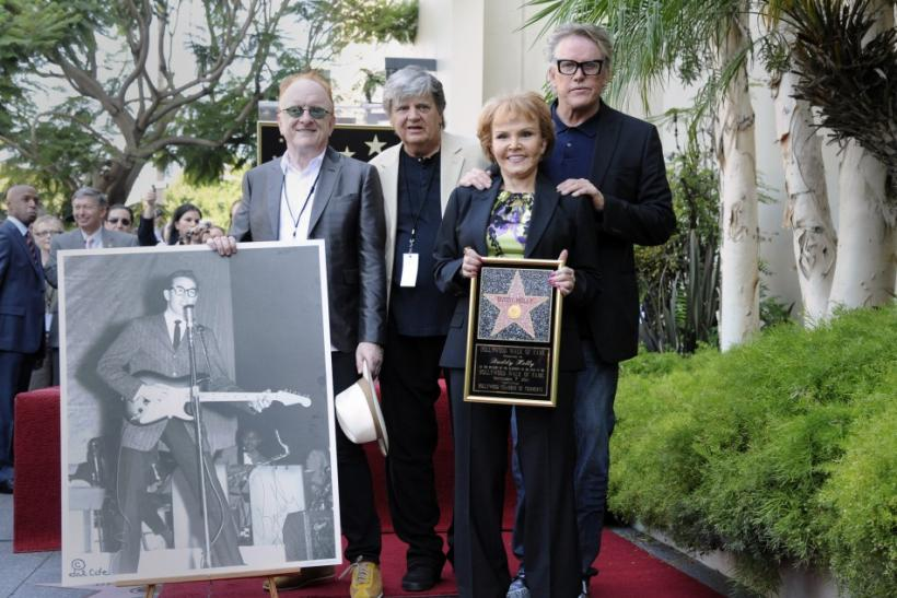 Producer Peter Asher (L-R), musician Phil Everly, late musician Buddy Holly's wife Maria Elena Holly and actor Garey Busey pose for photos during a ceremony where Buddy Holly posthumously receives a Star on the Hollywood Walk of Fame in Hollywood