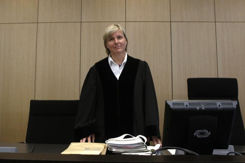 Judge Brueckner-Hofmann enters the courtroom for the pronouncement of a decision between Apple and Samsung in Duesselorf
