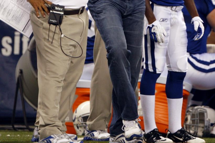 Colts Peyton Manning and Clyde Christensen talk during a preseason NFL football game in Indianapolis