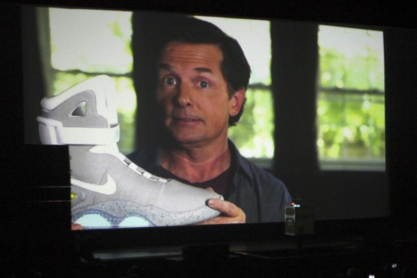 Actor Michael J. Fox is seen on a screen during a video message holding a 2011 NIKE MAG shoe