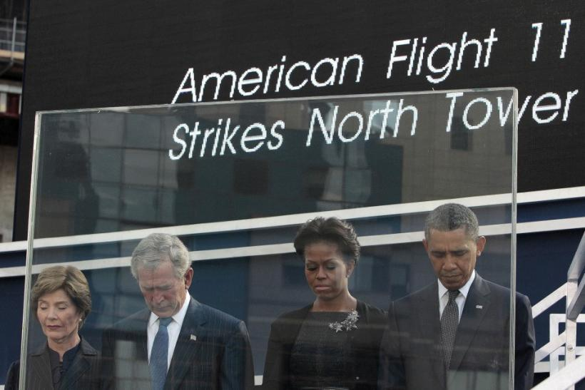 Bushs and Obamas bow their heads during a moment of silence during ceremonies marking the 10th anniversary of the 9/11 attacks on the World Trade Center, in New York