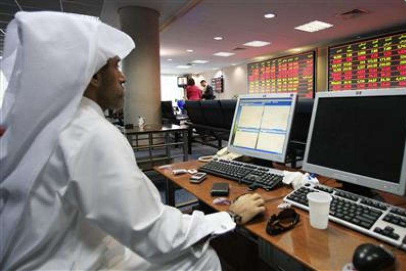 An investor monitors stock market activities at the Doha securities market