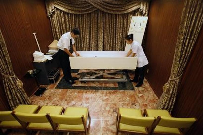 Morticians prepare a body at the Lastel corpse hotel in Yokohama, south of Tokyo, September 10, 2011. Death is a rare booming market in stagnant Japan and the Lastel corpse hotel, where bereaved families can check in their dead while they wait their turn
