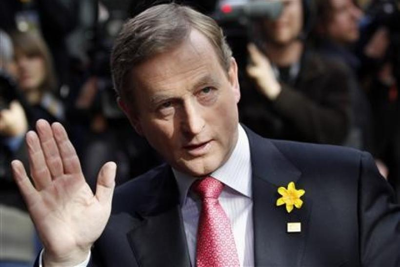 Irish Prime Minister Enda Kenny waves as he arrives at an European Union leaders summit in Brussels in this March 25, 2011 file photograph.