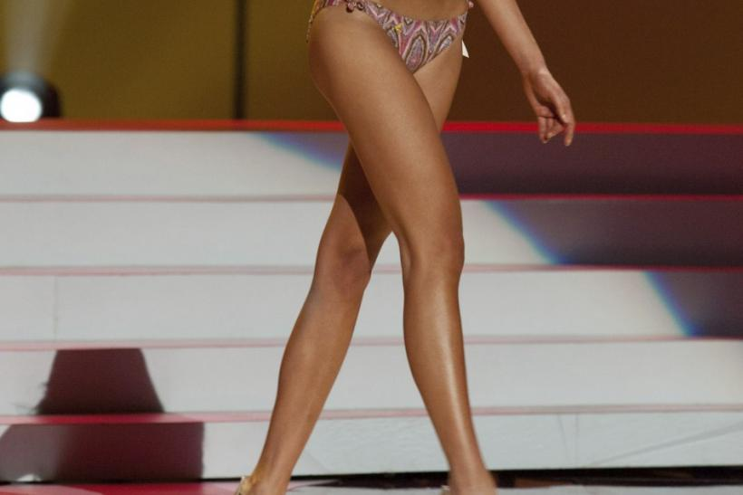Miss Universe China 2011 Luo Zilin wears a swimsuit during a presentation show at the Credicard Hall in Sao Paulo