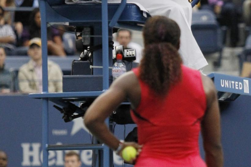 Serena Williams of the U.S. argues with the chair umpire during her match against Samantha Stosur of Australia in the finals at the U.S. Open tennis tournament in New York