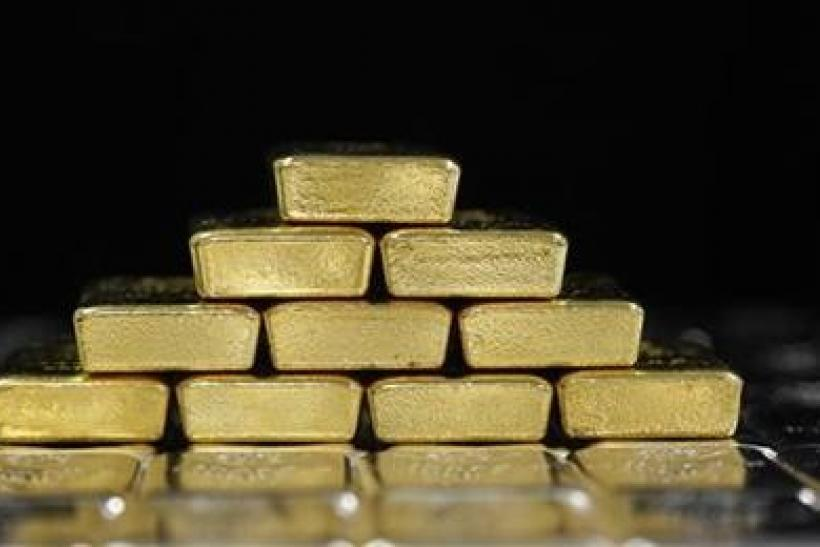 Gold eases as firmer dollar piles on pressure