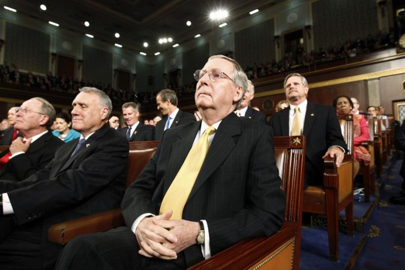 Senate Minority Leader Mitch McConnell (R-KY) listens as President Barack Obama addresses a joint session of the United States Congress in Washington
