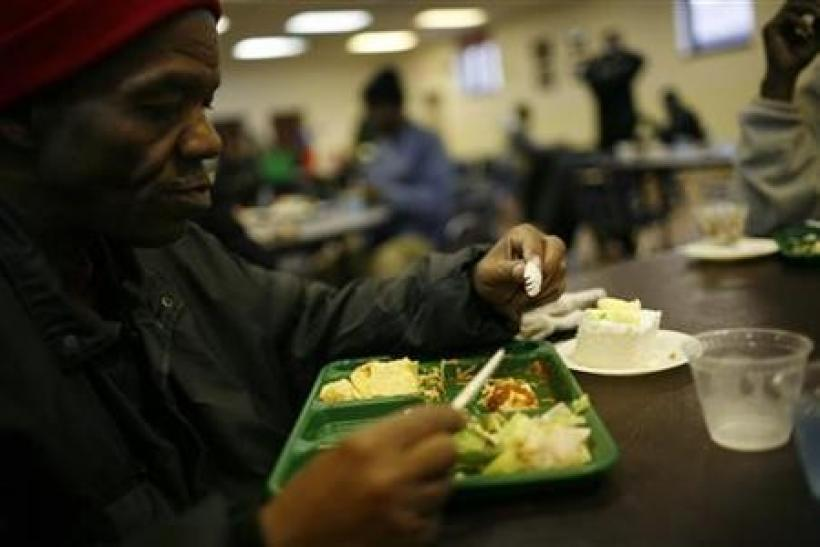 A man eats lunch at the Capuchin Soup Kitchen, where hundreds of people receive food and supplies everyday, in Detroit, Michigan