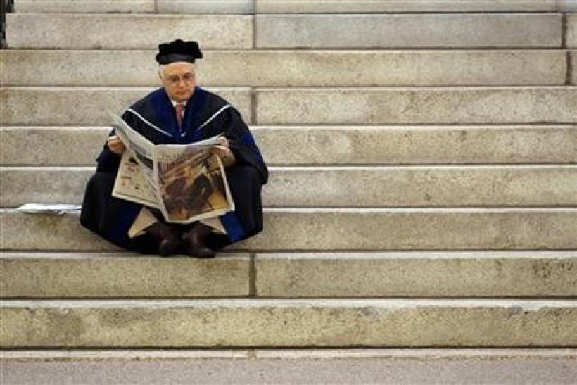 Thomas Michel, a professor at Harvard Medical School, waits for the start of the 360th Commencement Exercises at Harvard University in Cambridge, Massachusetts