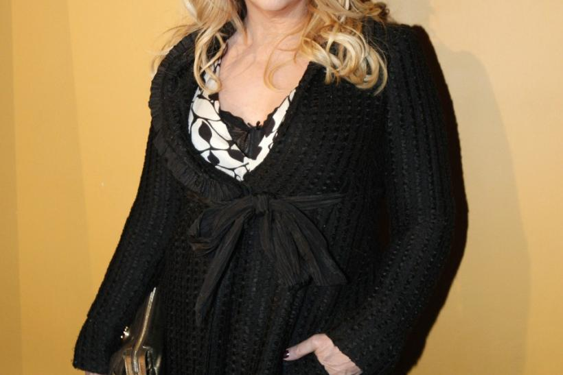 "Kirstie Alley poses for photographers as she arrives at the premiere of ""The Runaways"" in New York City March 17, 2010."