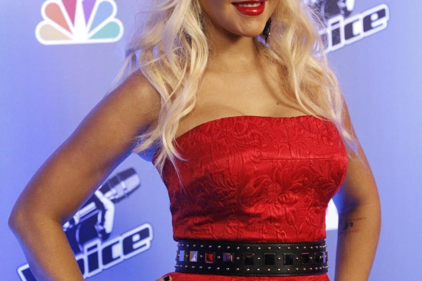"Aguilera poses during a media event for the upcoming television series ""The Voice"" in Los Angeles"
